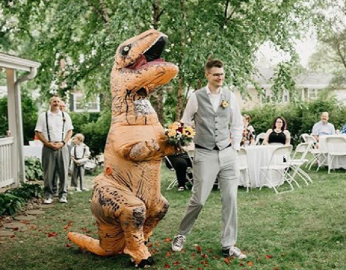 A maid of honour dressed as a T-rex for her sister's wedding – and got away with it