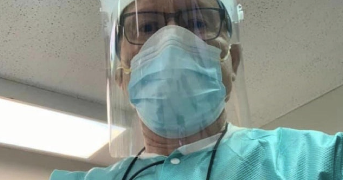 This dentist wears a photo so people know what he really looks like