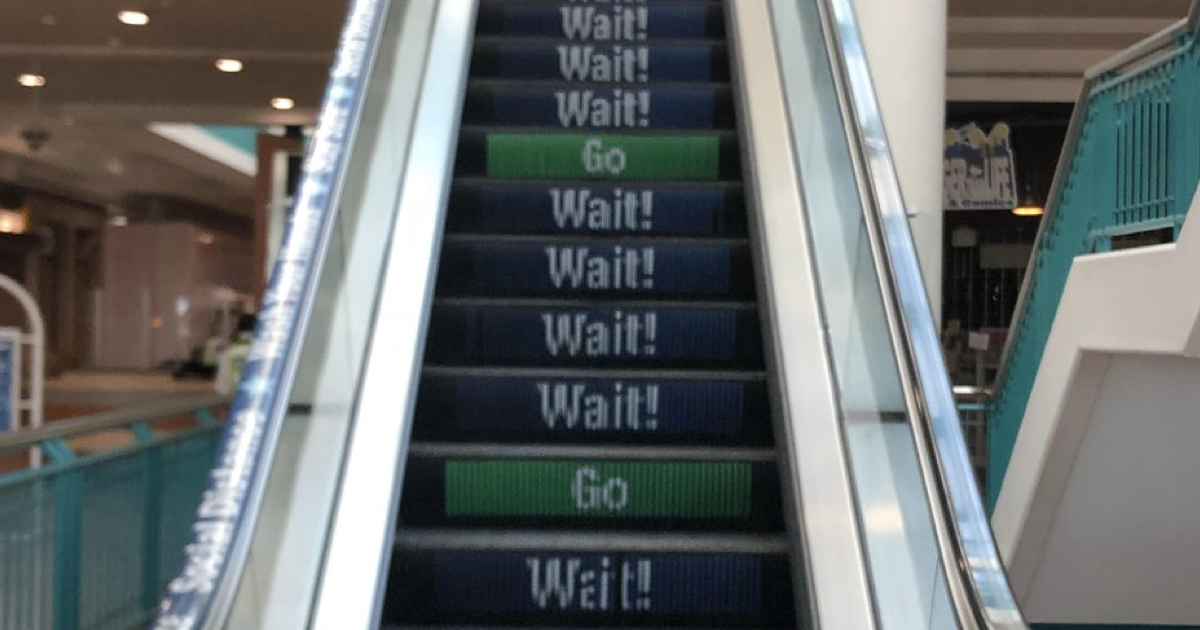 Whoever designed this 'social distancing escalator' is going up in the world - the poke